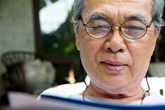 Senior man relaxing at home reading a book Royalty Free Stock Photo