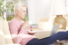 Senior man relaxing at home Stock Images