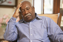 Free Senior Man Relaxing In Armchair Stock Photography - 9003912