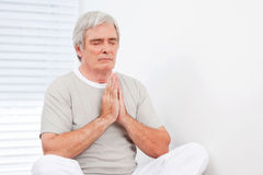Senior man at relaxing meditation Stock Photography