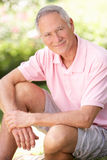 Senior man relaxing in a park Stock Image
