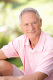 Senior man relaxing in a park Royalty Free Stock Image