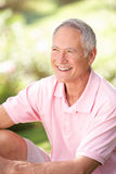 Senior man relaxing in a park Royalty Free Stock Images