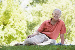 Senior man relaxing in park Stock Image