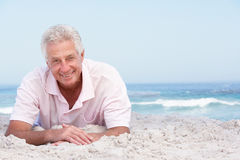 Senior Man Relaxing On Sandy Beach Stock Photos