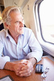 Senior Man Relaxing On Train Journey Royalty Free Stock Images