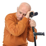 Senior man resting on crutch Stock Images
