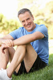 Senior Man Resting After Exercising In Park Stock Image