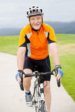 Senior man riding bicycle Royalty Free Stock Images