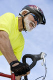 Senior Man Riding Bicycle Stock Photos