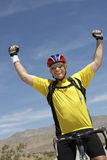 Senior Man Riding Bicycle And Cheering Royalty Free Stock Photos