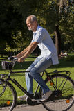 Senior Man Riding Bicycle Stock Images
