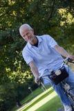 Senior Man Riding Bicycle Stock Photography