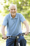 Senior man riding bike Royalty Free Stock Photos