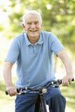 Senior man riding bike Royalty Free Stock Photos