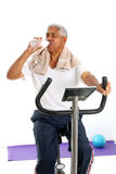 Senior Man Riding Bike Stock Photography