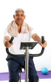 Senior Man Riding Bike Royalty Free Stock Photo