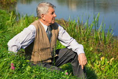 Senior man by the river Royalty Free Stock Images