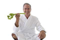 senior man in robe eating celery, cut out stock photos