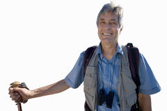 Senior man with rucksack holding hiking stick, cut out stock photos