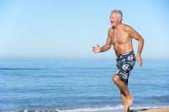 Senior Man Running Along Summer Beach Royalty Free Stock Image