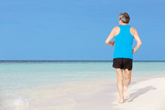 Senior Man Running On Beautiful Beach Stock Photos