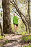 Senior Man Running in the Forest Stock Images