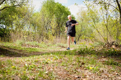 Senior Man Running in the Forest Royalty Free Stock Photos