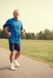 Senior man running. Stock Image