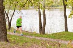 Senior Man Running by the Lake Stock Photos