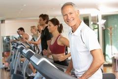 Senior Man On Running Machine. In Gym Royalty Free Stock Photos