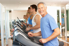 Senior Man On Running Machine Royalty Free Stock Image