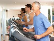 Senior Man On Running Machine. In Gym Stock Photos