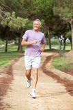 Senior man running in park Royalty Free Stock Images