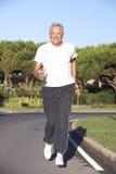 Senior Man Running On Road Stock Images
