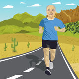 Senior man running or sprinting on road in mountains. Fit mature male fitness runner during outdoor workout Stock Photos