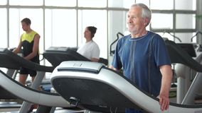 Senior man running on treadmill.