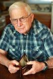 Senior man's empty wallet royalty free stock photo
