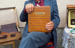 Senior man's hand touching an old photo album. Royalty Free Stock Images