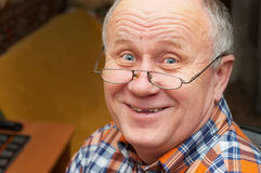 Senior man's smile. Casual bald senior man with glasses are smiling. Emotional portrait series Stock Images