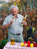 Senior man sampling wine Royalty Free Stock Image