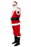 Senior man in Santa costume pointing at you Royalty Free Stock Photos