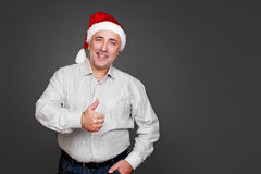 Senior man in santa hat standing Royalty Free Stock Photo
