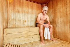 Senior man in the sauna at the spa hotel. Senior man in the sauna sweats for health at the Wellness Hotel stock photos