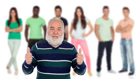 Senior man saying Ok with young people of background stock photos