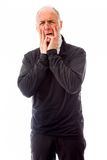Senior man scared with head in hands Royalty Free Stock Photos