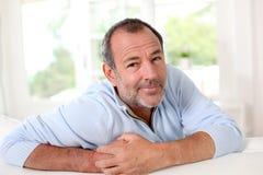 Senior man with sceptical look Stock Photos