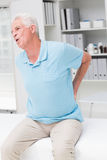 Senior man screaming due to back pain Royalty Free Stock Image