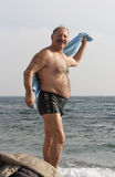 Senior man after sea bathing Royalty Free Stock Photography