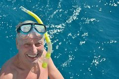 Senior man at sea with snorkeling mask Royalty Free Stock Images